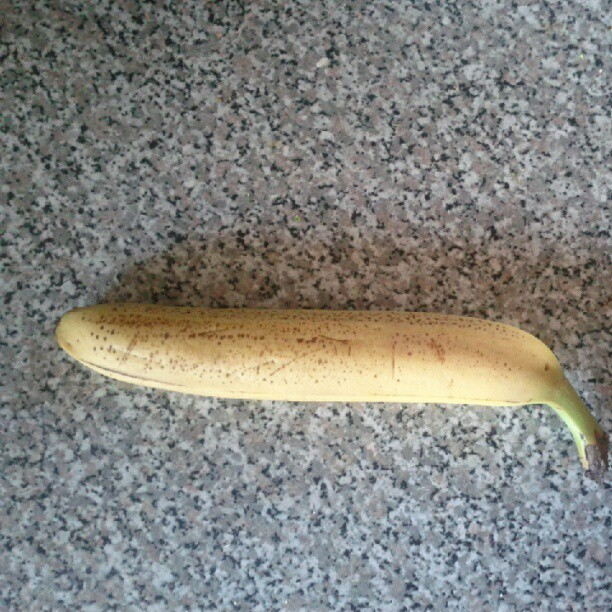 a photo of a banana sitting on a counter