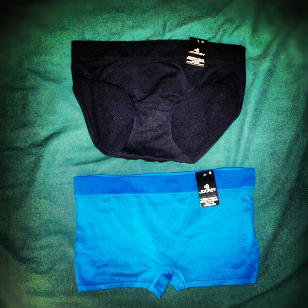 a photo of some black briefs and some blue boxers