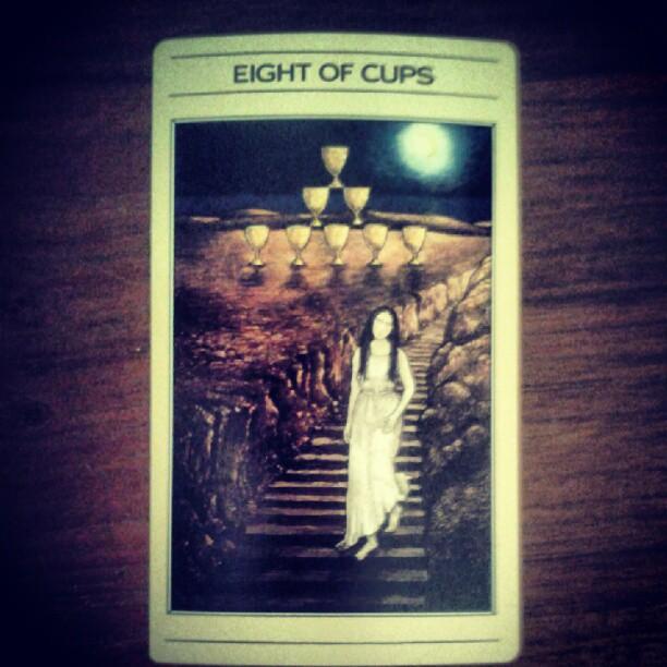 a photo of an eight of cups tarot card