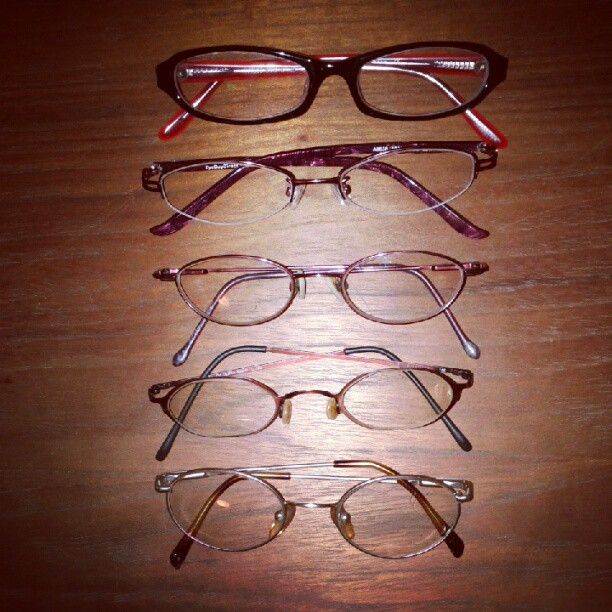 a photo of five different pairs of glasses lined up