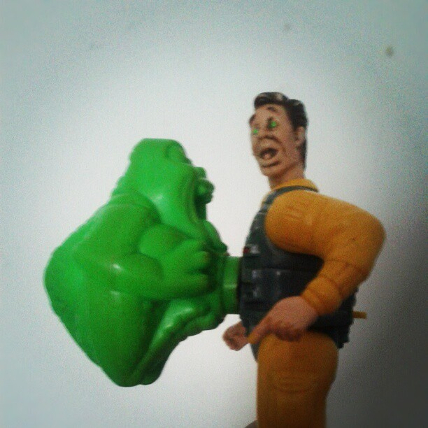 a photo of a The Real Ghostbusters screaming heroes peter venkman and slimer toy