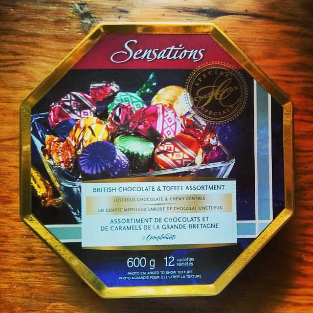 a photo of a sensations british chocolate and toffee assortment tin