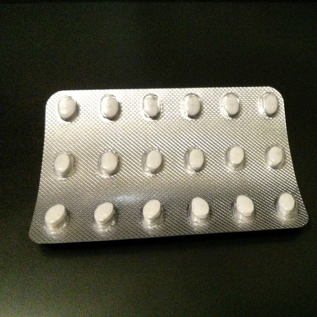 a photo of a blister pack full of small white pills