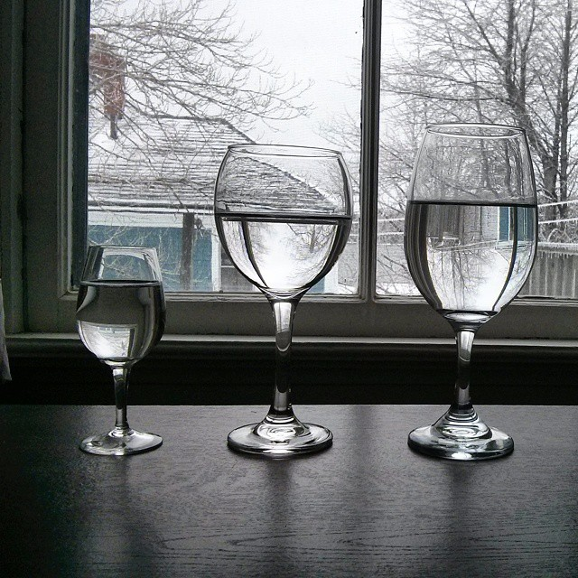a photo of three different types of glasses filled with water