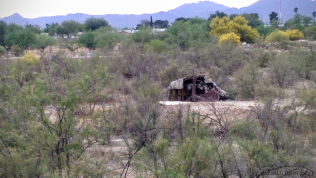 shanty in the middle of dry rillito river