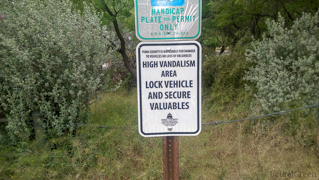 "sigh that reads ""HIGH VANDALISM AREA LOCK AND SECURE VALUABLES"""