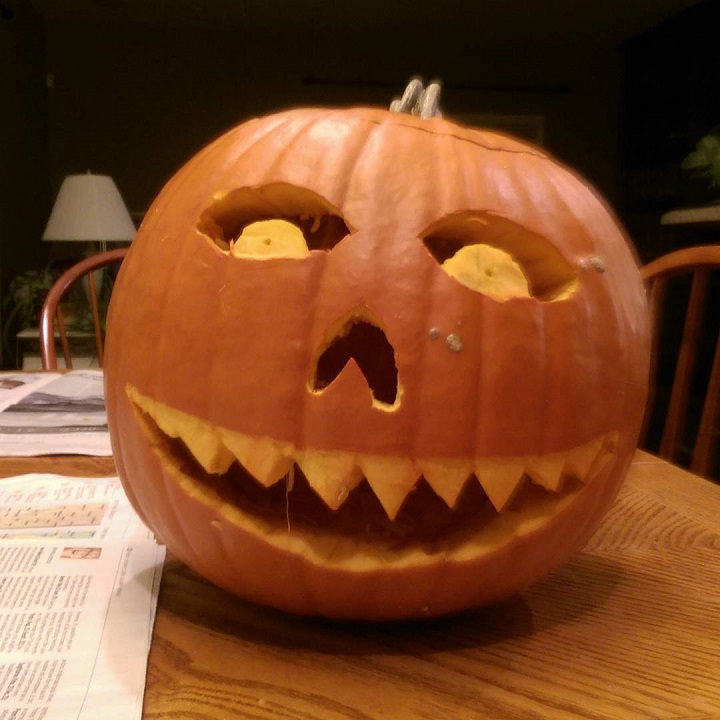 photo of a jack o' lantern on a table