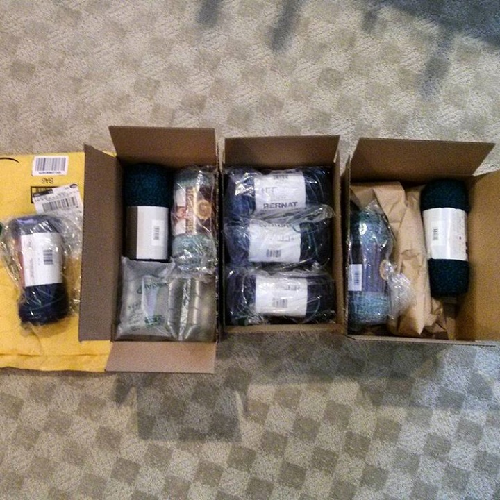 a photo of and amazon order of yarn that came in three separate box and an envelope