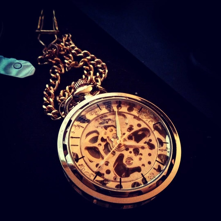 a photo of a gold skeleton pocket watch