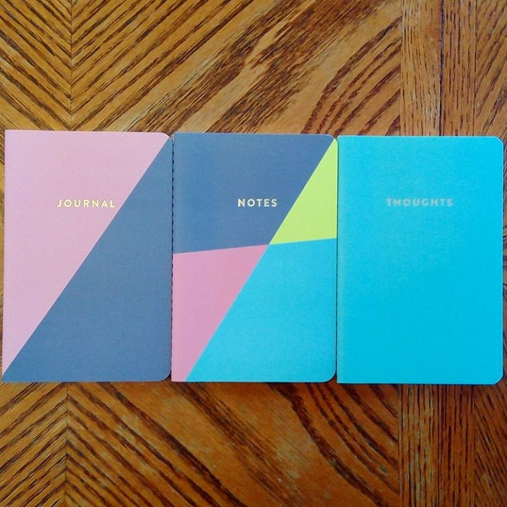 "a photo of three ""aesthetic"" notebooks"