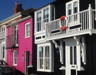 The bright pink and blue colours of houses on some streets.