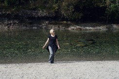 Portrait image of a young woman walking back from a river