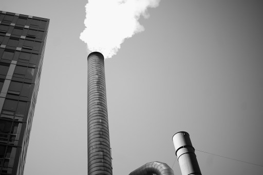 Black and white image of a steaming chimney at a brewery in downtown Seattle