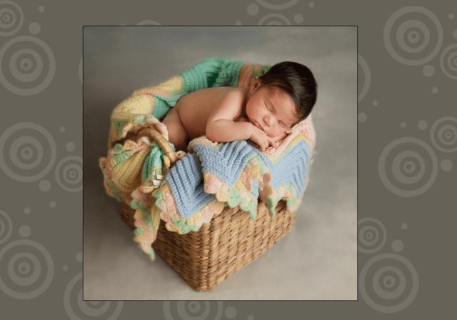 Newborn photography sleeping baby in basket