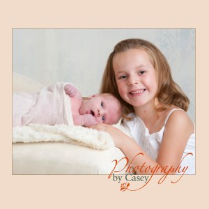 newborn baby with sister photography