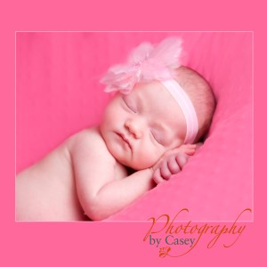 newborn sleeping baby with pink flower headband photography