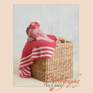 newborn sleeping baby posed in basket
