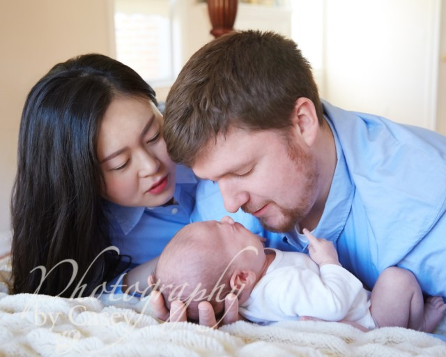 first portrait of newborn with parents