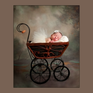 Photography of sleeping newborn in antique carriage
