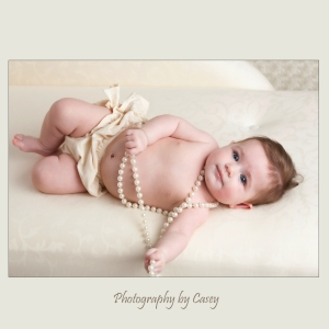 photography of baby with pearls