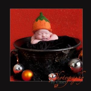 Photograph of newborn baby in Halloween pose