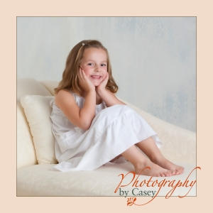 little girl posed on chaise