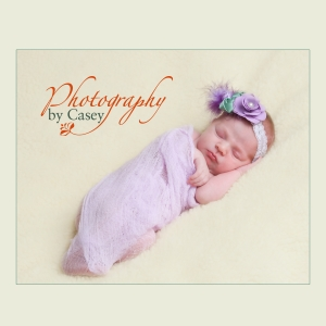 newborn baby swaddled in purple photography