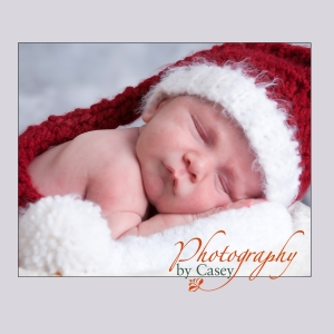 Sleeping newborn baby in Santa hat