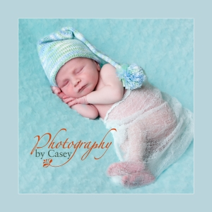 Newborn baby wearing stocking hat