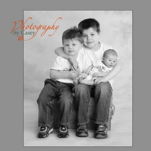 Photography of brothers with new born brother