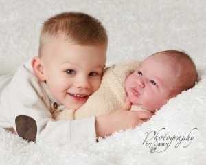 newborn photography with big brother