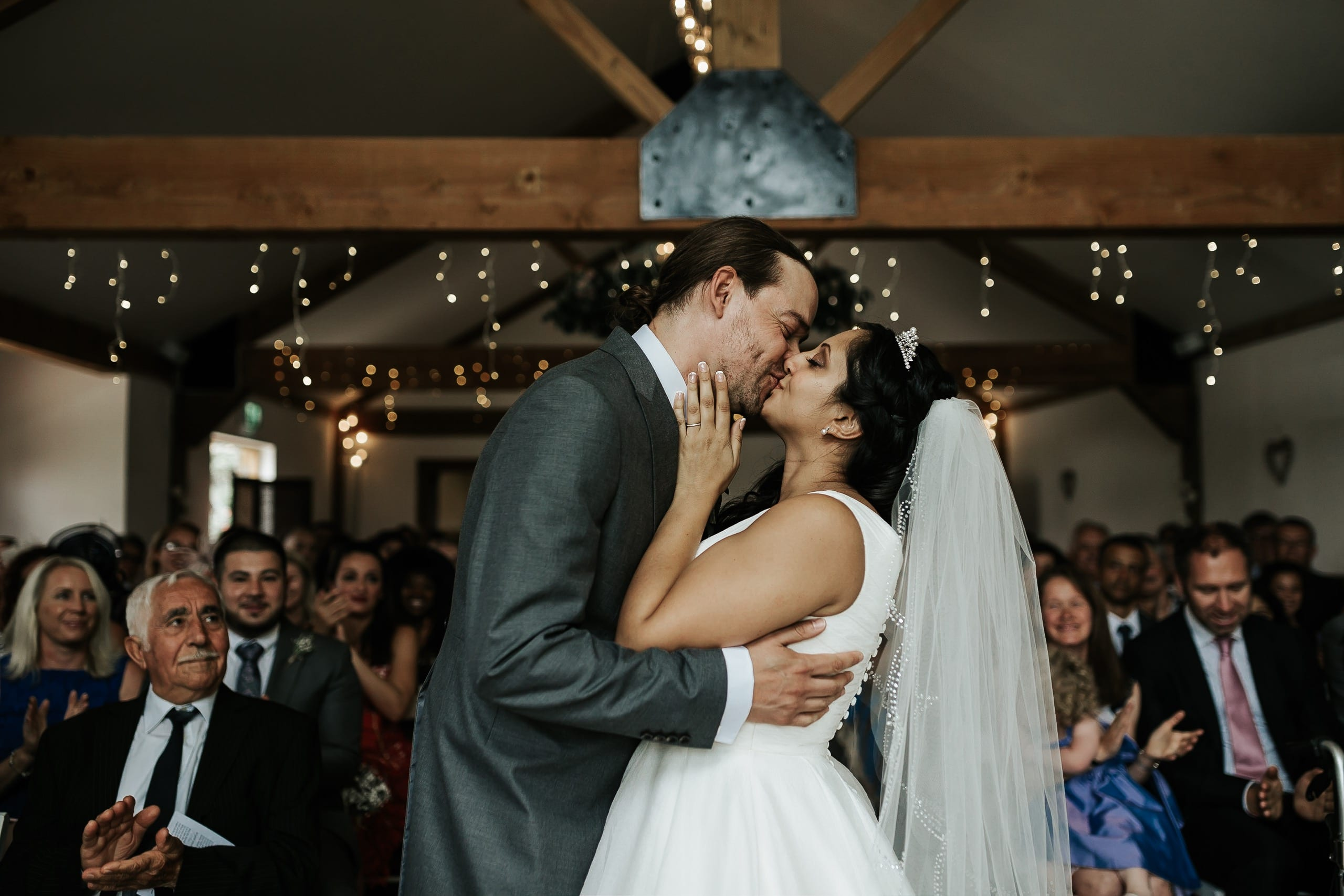 Kissing under fairy lights and beams