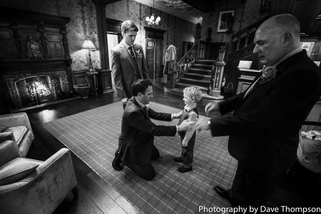 The Bets man helps his son with his suit