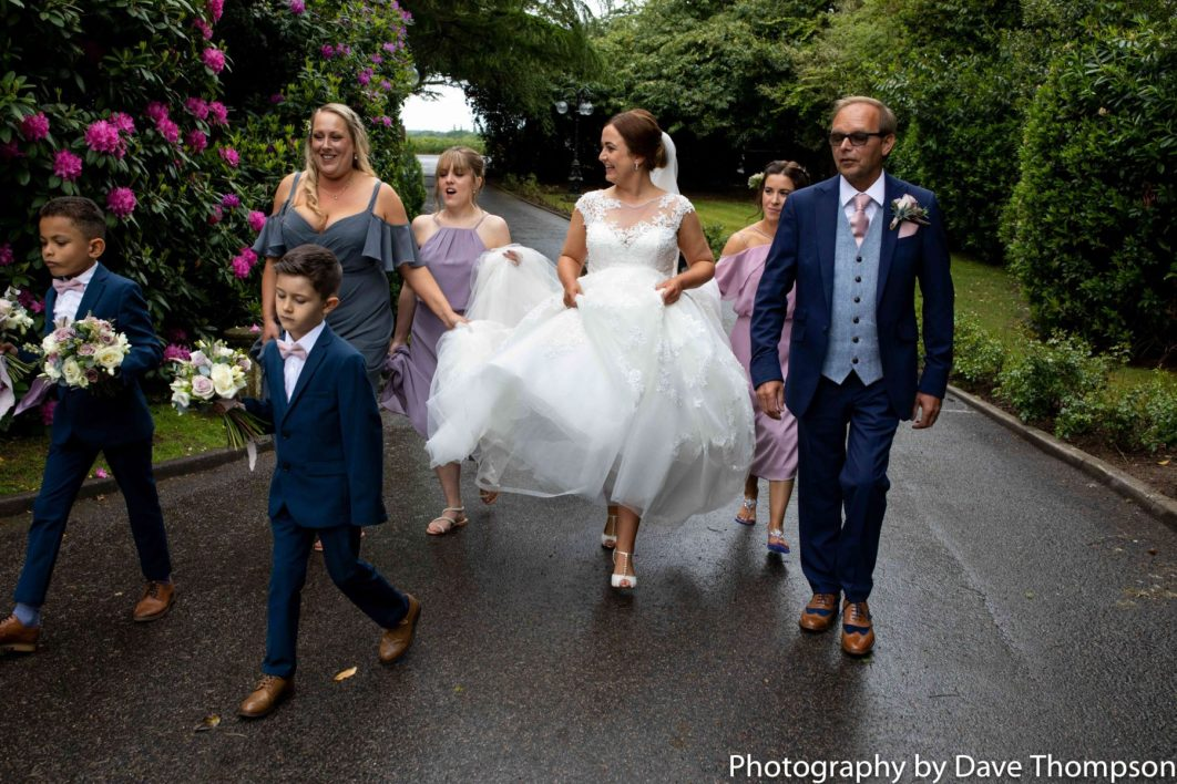 The bridal party make their way up the drive at the Mere Court Hotel
