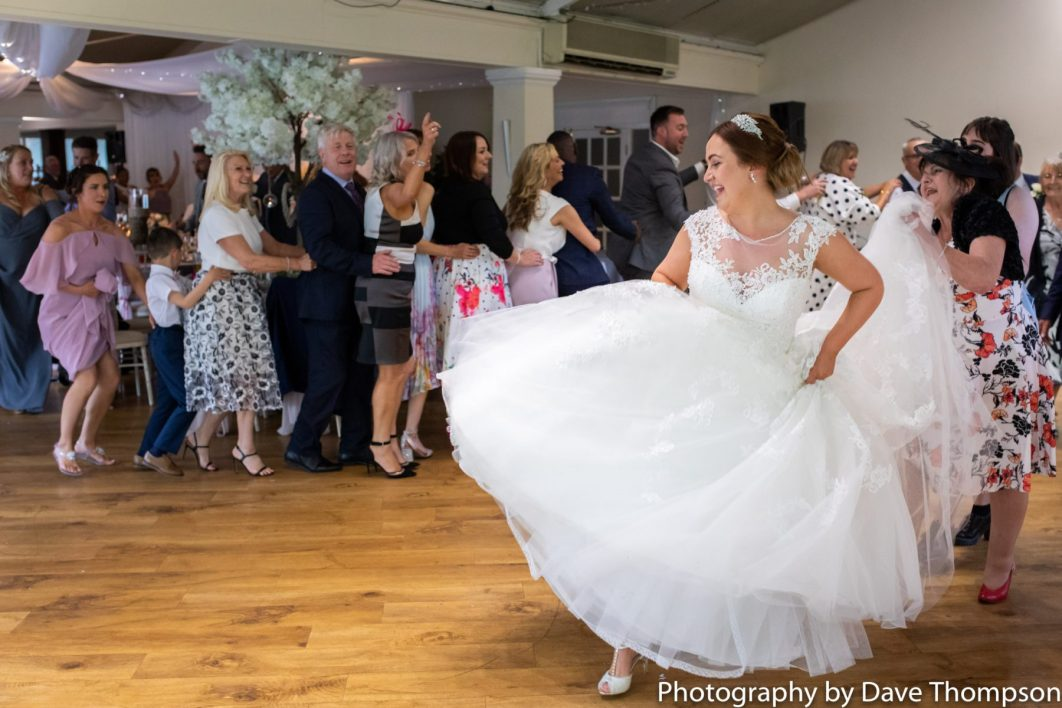 The bride leads a conga around the room