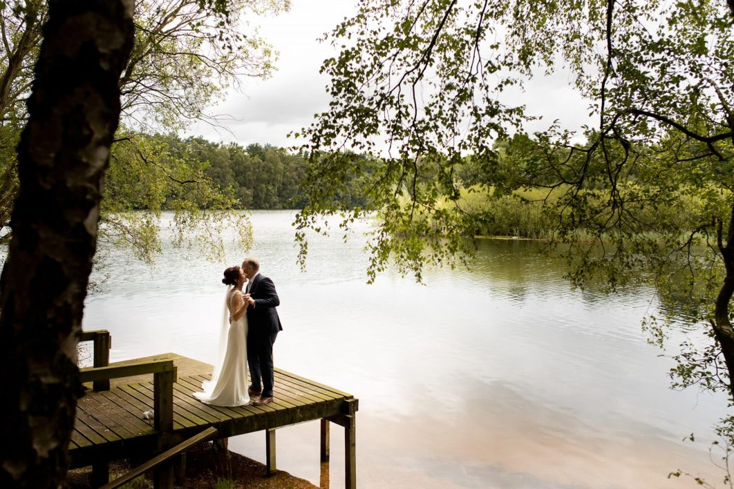 A bride and green dance by the 60acre lake at Nunsmere Hall