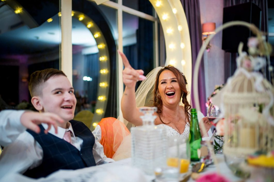 Hollin Hall Hotel Wedding Photographer - The bride and her son laugh during the wedding breakfast