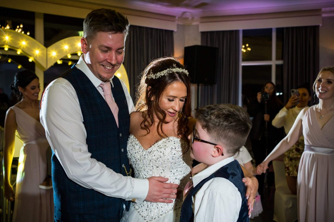 Hollin Hall Hotel Wedding Photographer - The bride and groom with one of their sons