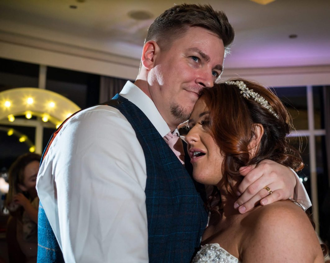 Hollin Hall Hotel Wedding Photographer - A portrait of the bride and groom during thier first dance