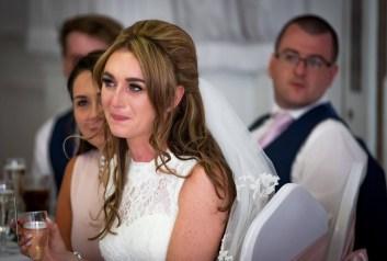 Emotional bride during speeches