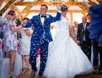 Bride and Groom dance down the aisle