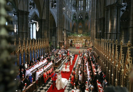 The bride and groom leave Westminster Abbey after their wedding