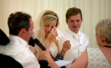 The bride wipes a tear during her fathers speech