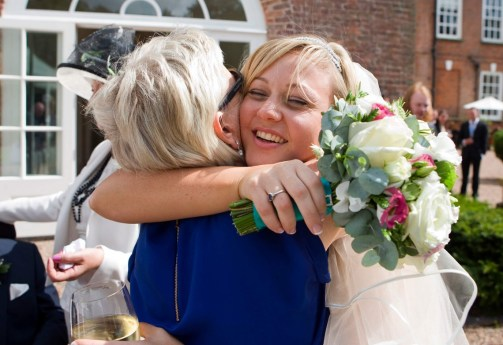 The bride hugs her Auntie
