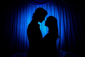 Bride and Groom silhouette against a blue background