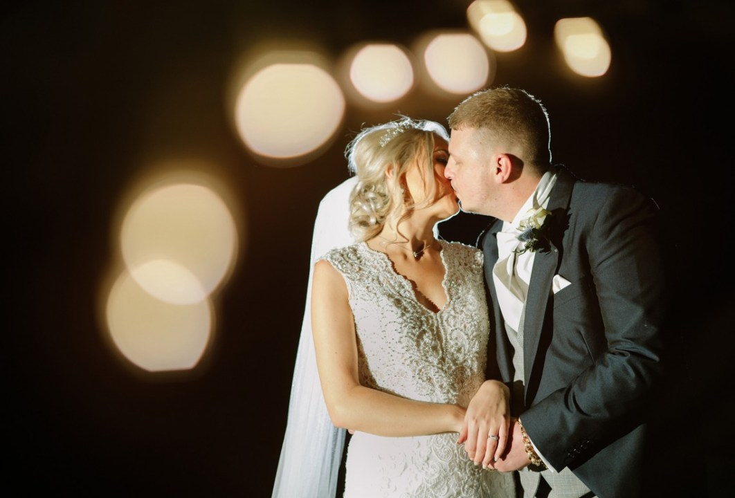 Bridal portrait with fairy lights outside