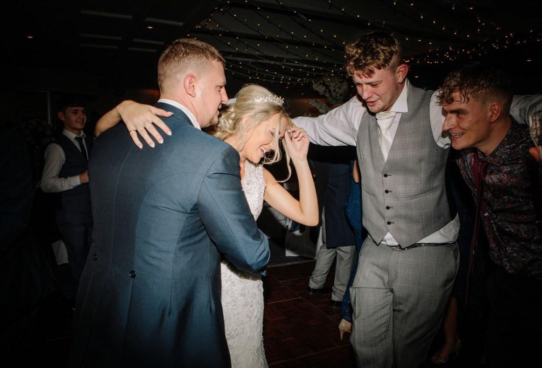 Bride & Groom dancing with guests