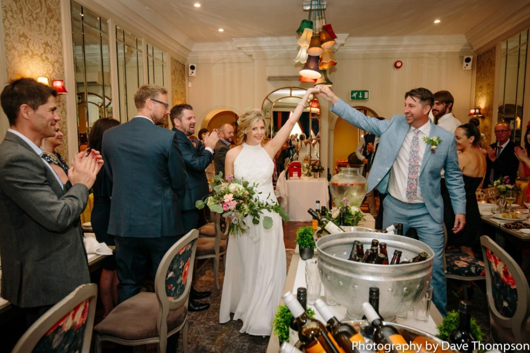 Bride and groom are greeted by guests