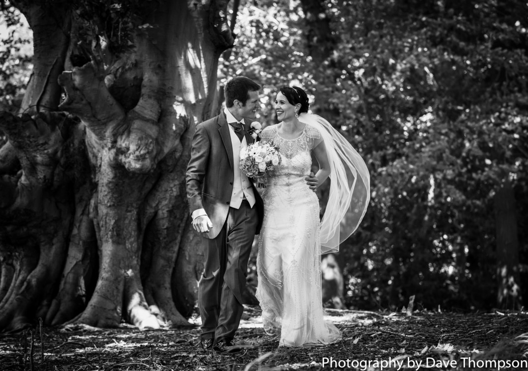 Black and white image of the bride and groom in the woods