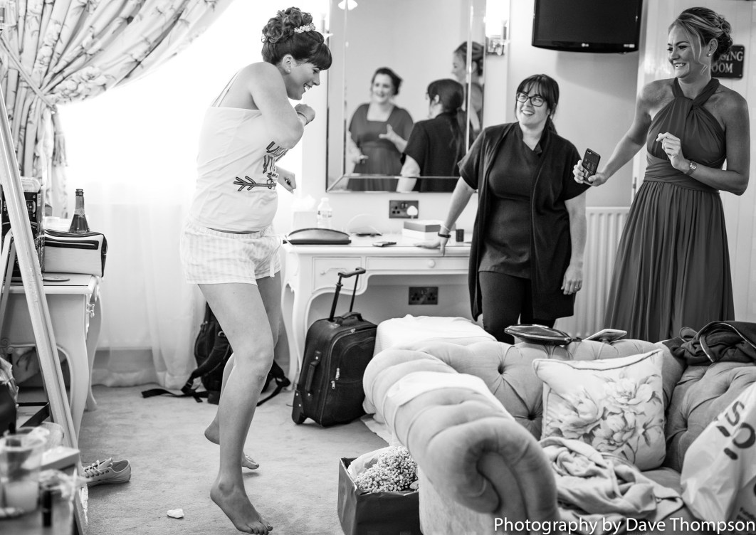 Dancing bride during bridal prep